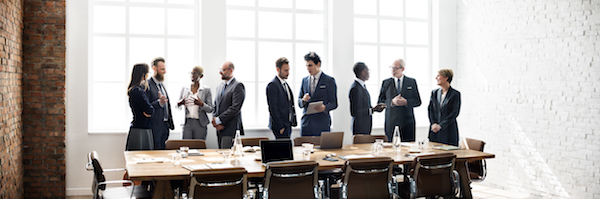 Grop of business professionals gathered around a conference table