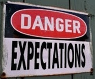 Signboard with text - Danger! Expectations